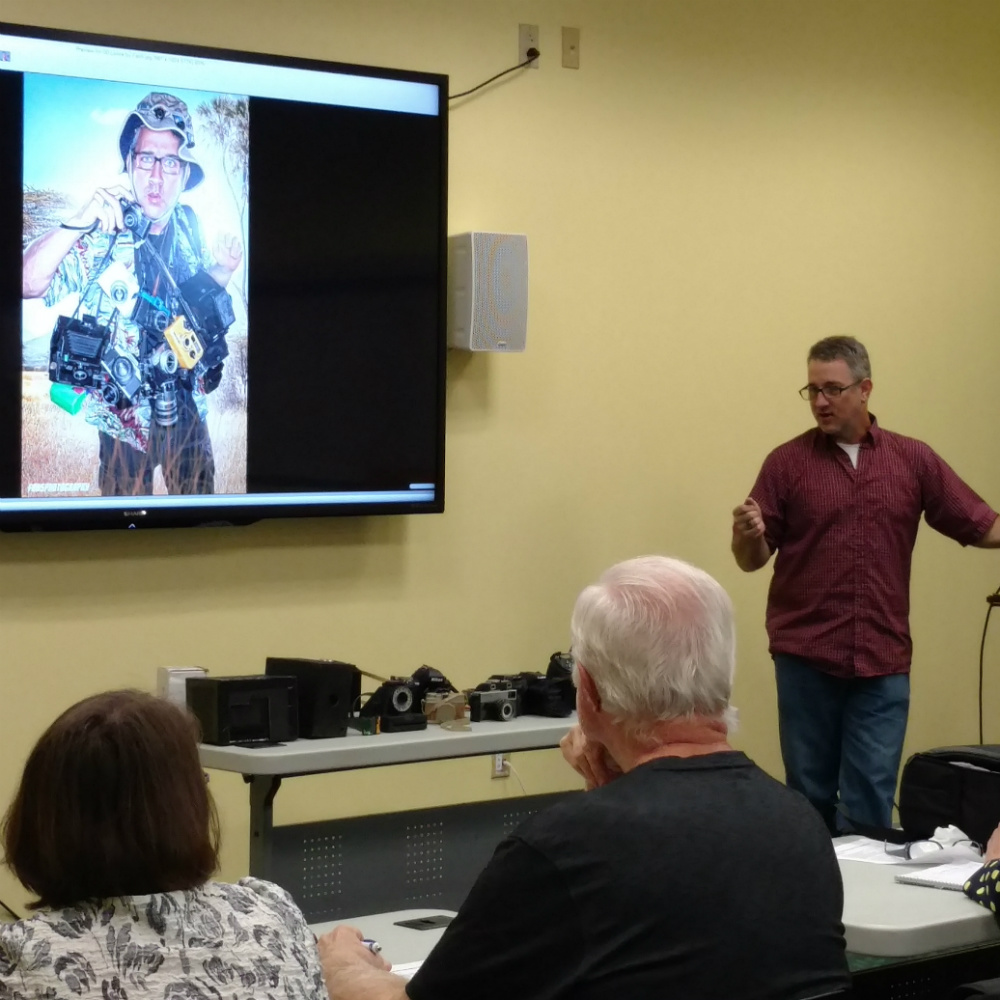 Image of instructor using wall mounted large screen for teaching