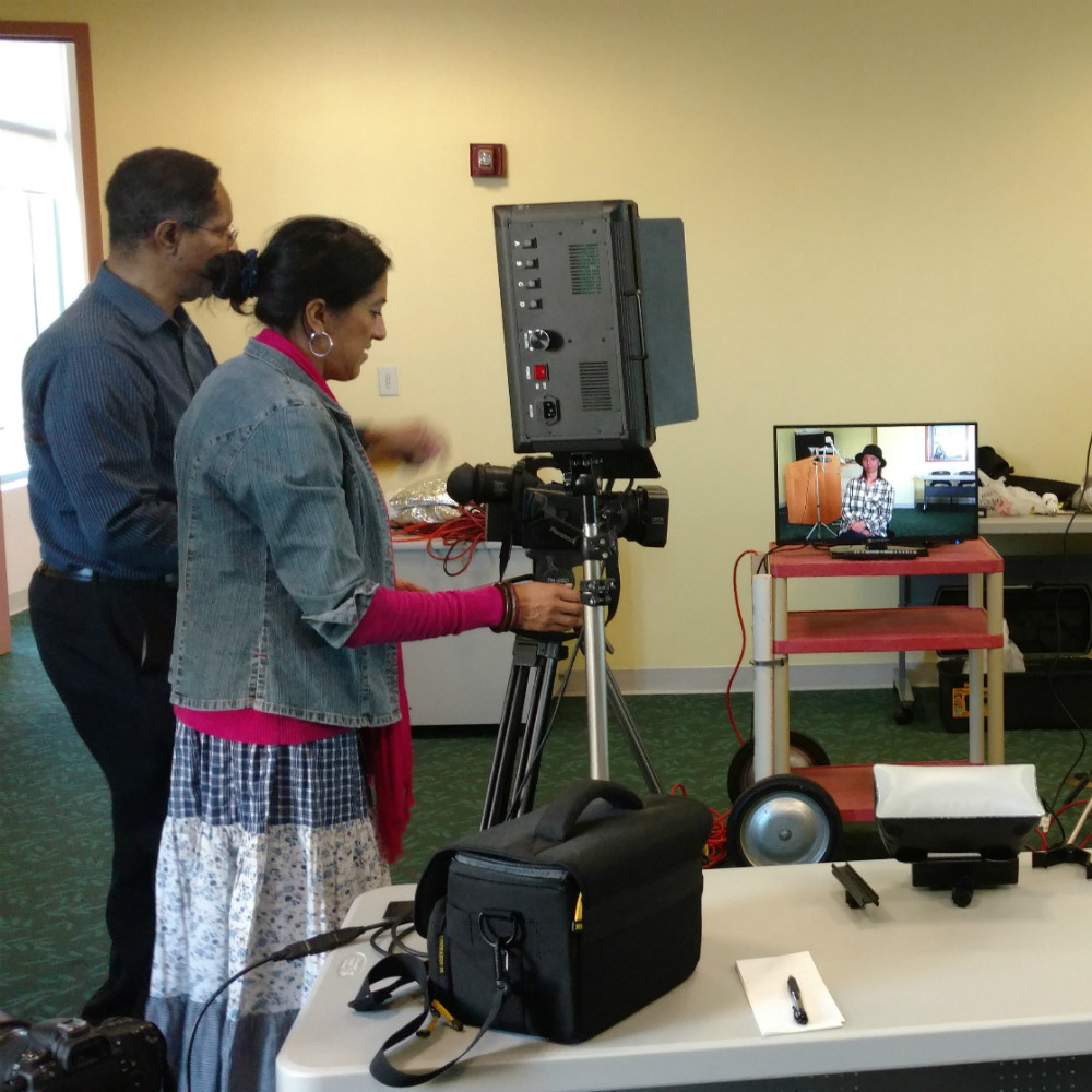 Image - Two people using video equipment